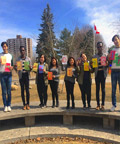 students holding letters that spell embrace diversity