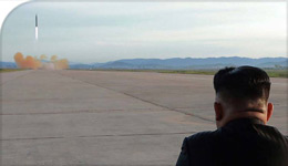 Kim Jong Un looks at missile launch in undated photo from National Post | 2017-10-14
