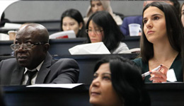 Internationally Educated Professionals Bridging Program alumni and students in the classroom