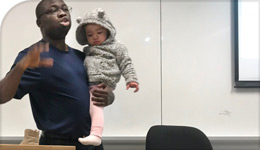 Professor Tokunbo Ojo holding Larissa Crawford's daughter Zyra | CBC | 2018-03-02