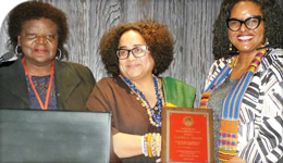 Professor Caroline Shenaz Hossein receiving a WEB DuBois award | group photo | 2018-04-02