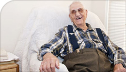 Photo of elderly man in a chair from Pat Armstrong article on nursing home clothes and laundry in The Conversation | 2018-08-16