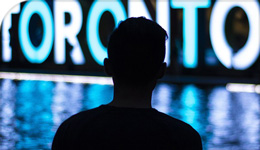 Photo of Toronto sign and silhouette of a person in front of it | 2018-08-29