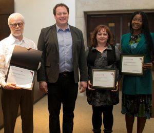 Image of award winners and Interim Dean